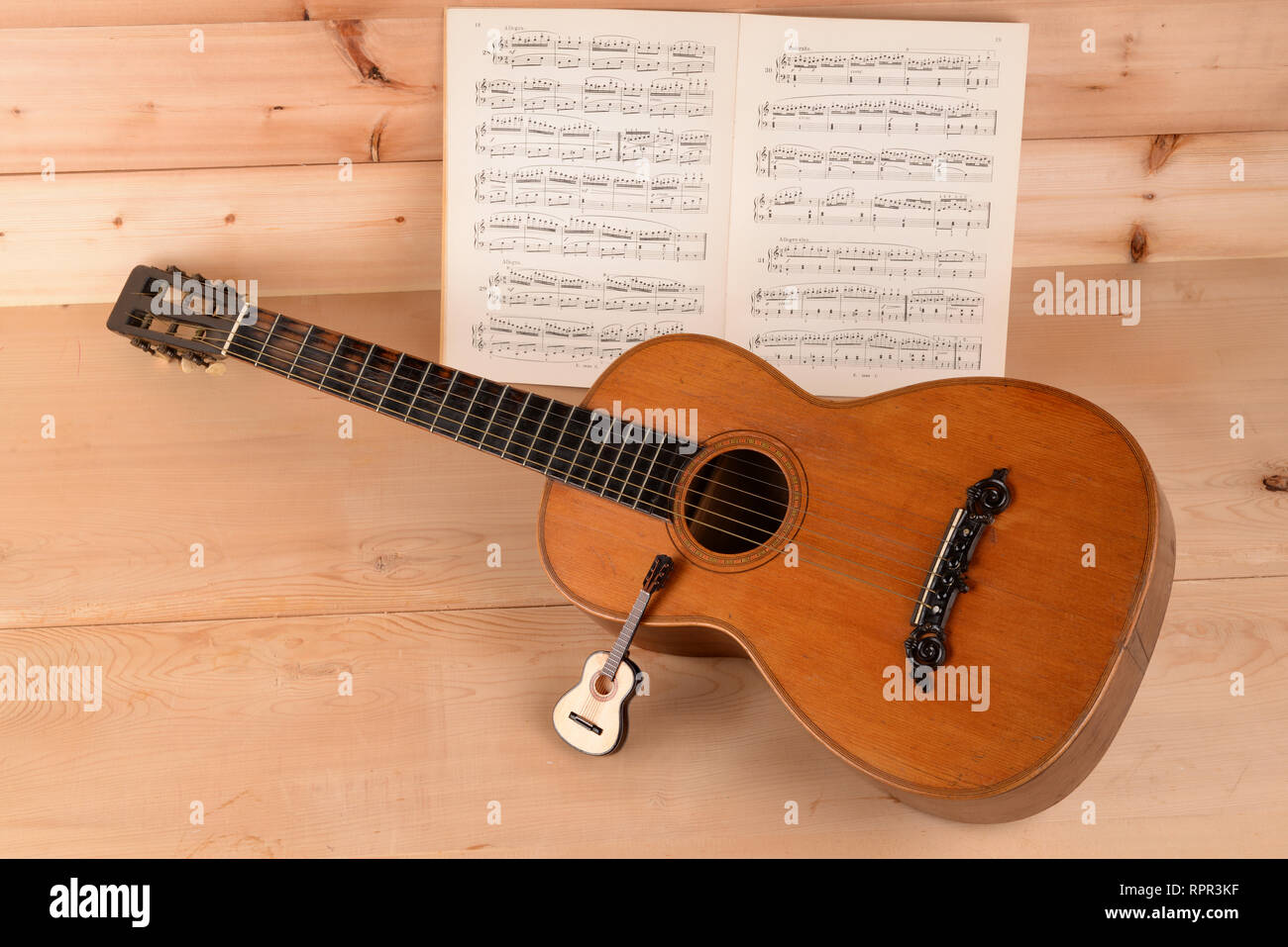 musical instruments, large and small guitar - Stock Image