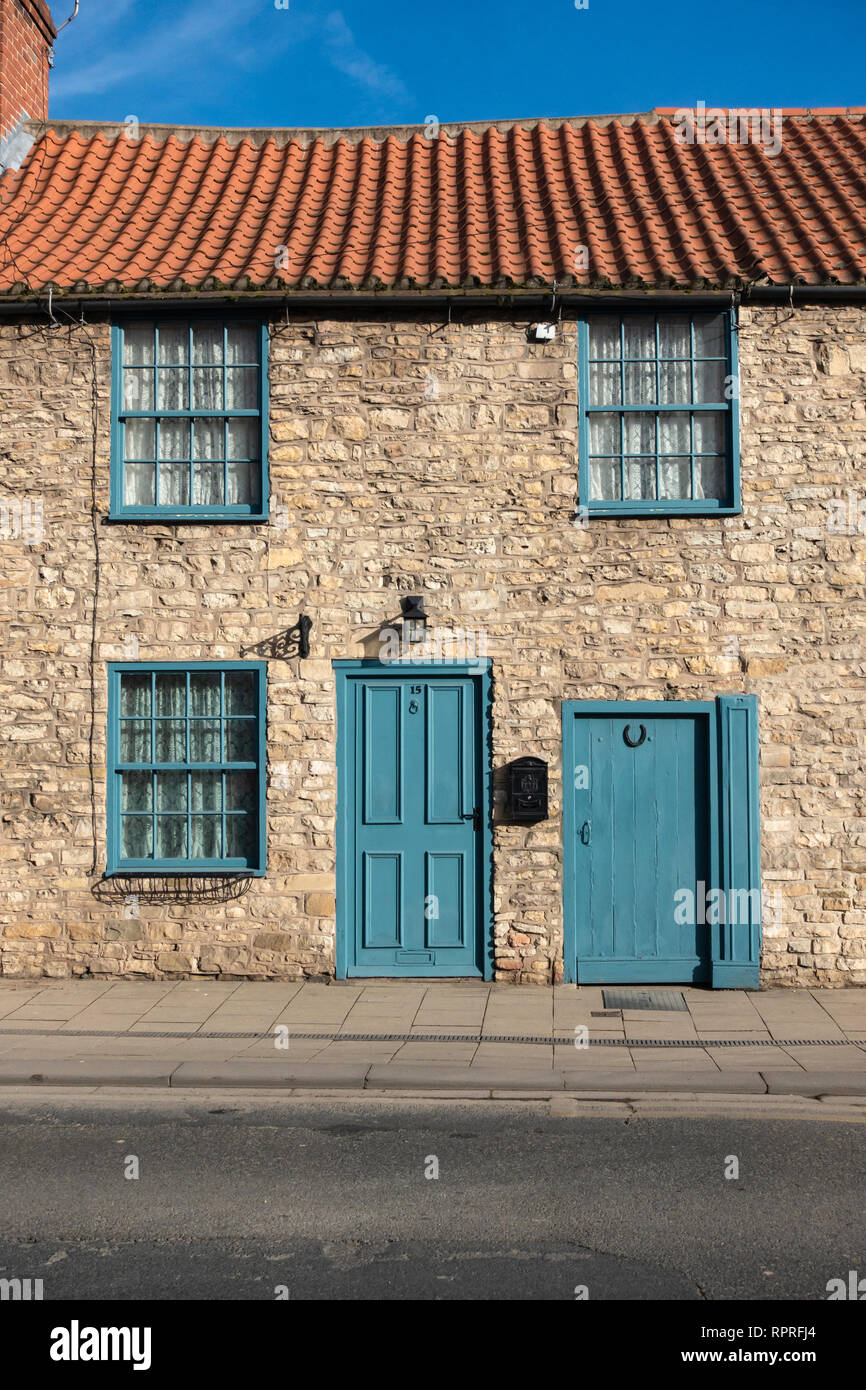 English Village, Pretty Stone built cottage in Market Place, Tickhill in the Metropolitan Borough of Doncaster in South Yorkshire, England, Stock Photo