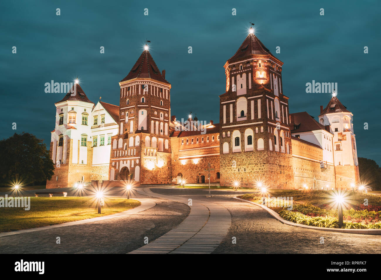 Mir, Belarus. Mir Castle Complex In Evening Night Illumination Lighting. Famous Landmark. UNESCO Heritage. Architectural And Cultural Heritage. - Stock Image