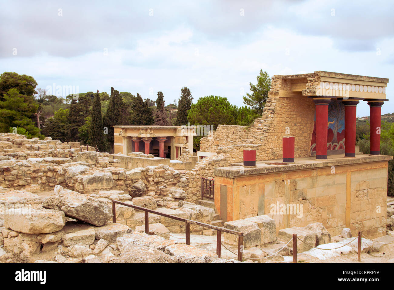 View on Red columns and ruins of  Minoan Knossos Palace. Wide shot. No people. Heraklion, Crete Island, Greece. - Stock Image