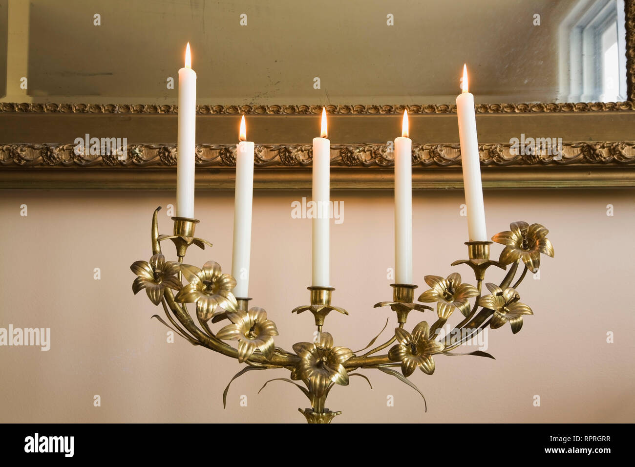 Close-up of candelabra with lit candles in master bedroom on ...