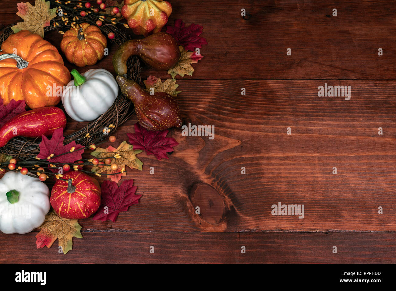 Thanksgiving decor with pumpkins, gourd, squash, maple leaves and berries Stock Photo