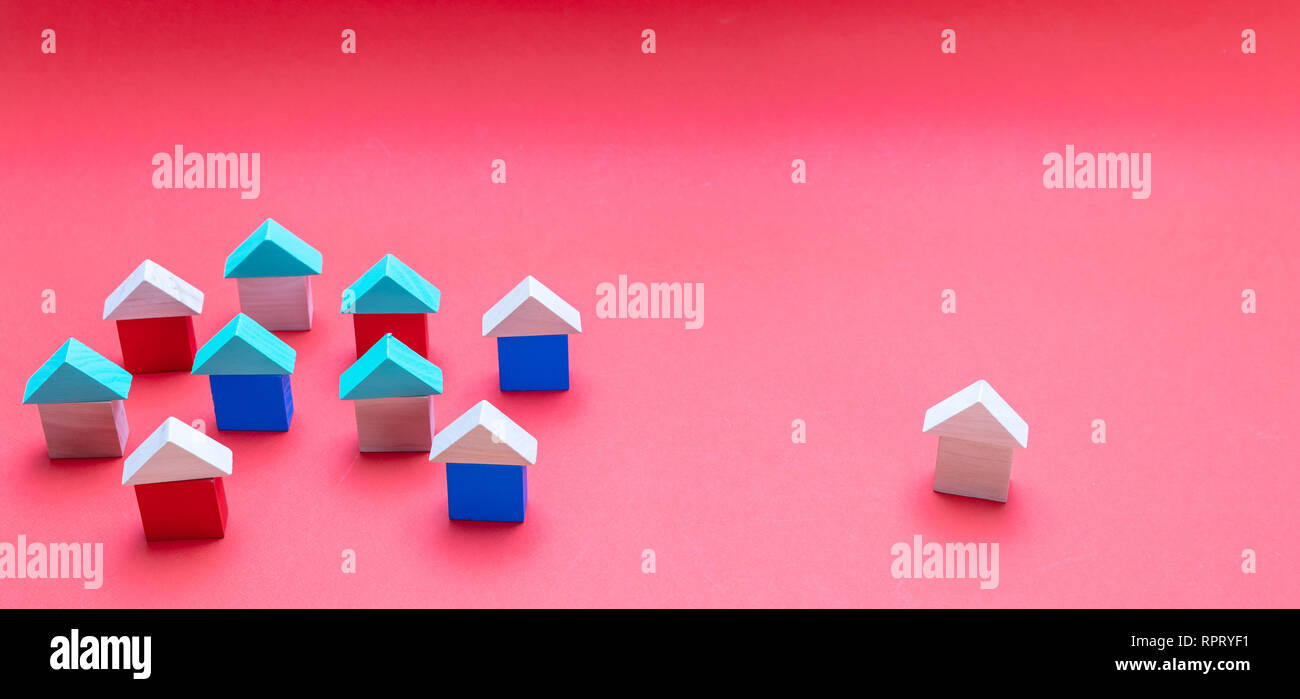 Real estate and standing out concept, One house model away from the others, red color background Stock Photo