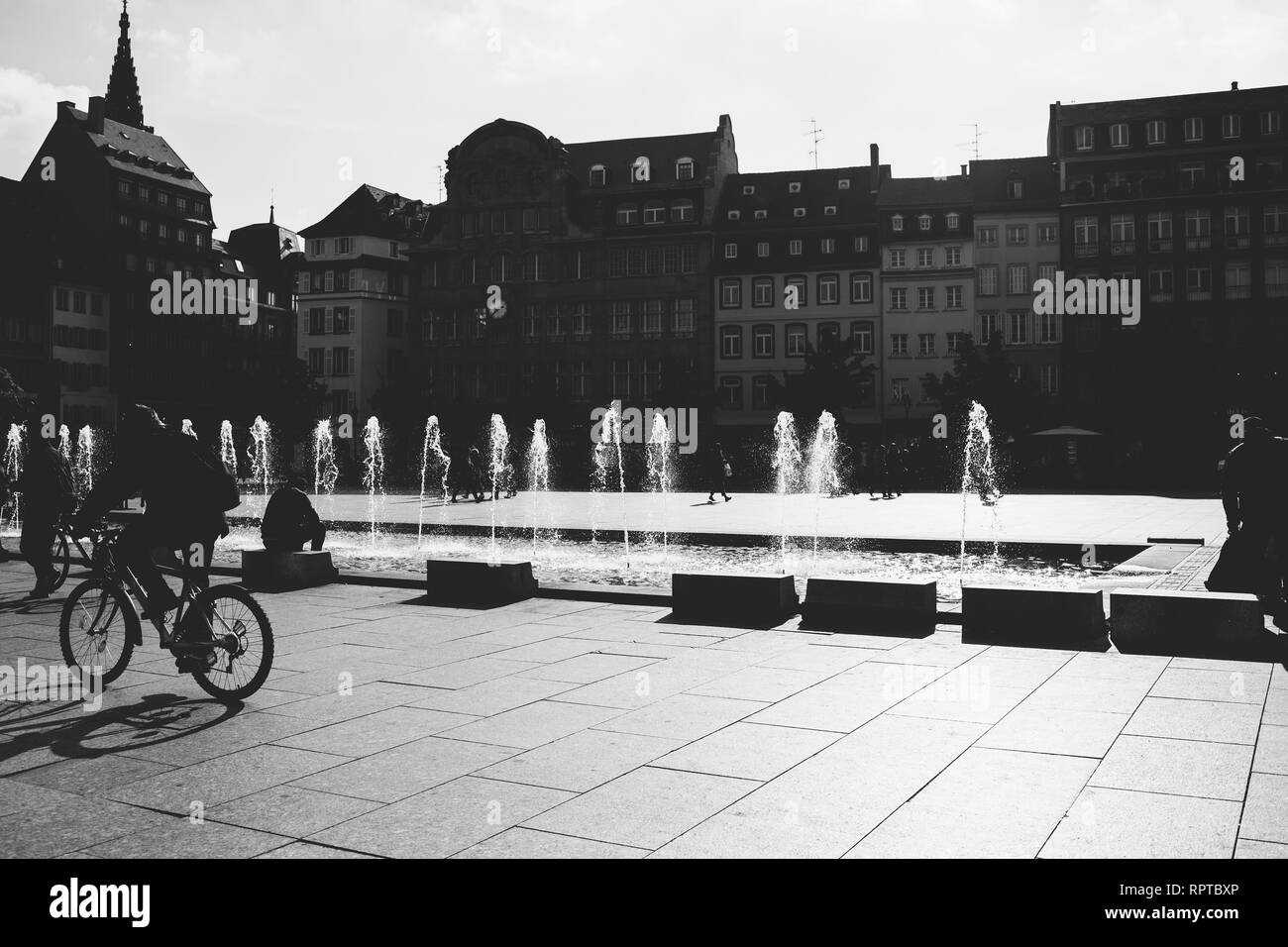 STRASBOURG, FRANCE - OCT 26, 2018: Strasbourg Place Kleber on a warm summer day with hundreds of people tourists and locals walking in the morning - black and white - Stock Image