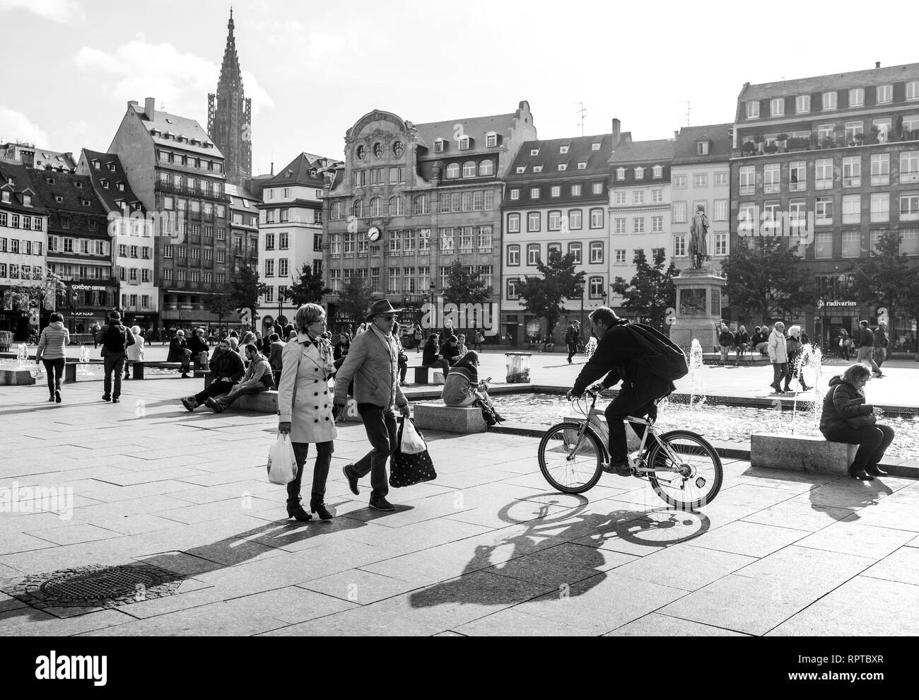 STRASBOURG, FRANCE - OCT 26, 2018: Strasbourg Place Kleber on a warm summer day with hundreds of people tourists and locals walking in the morning couple black and white - Stock Image