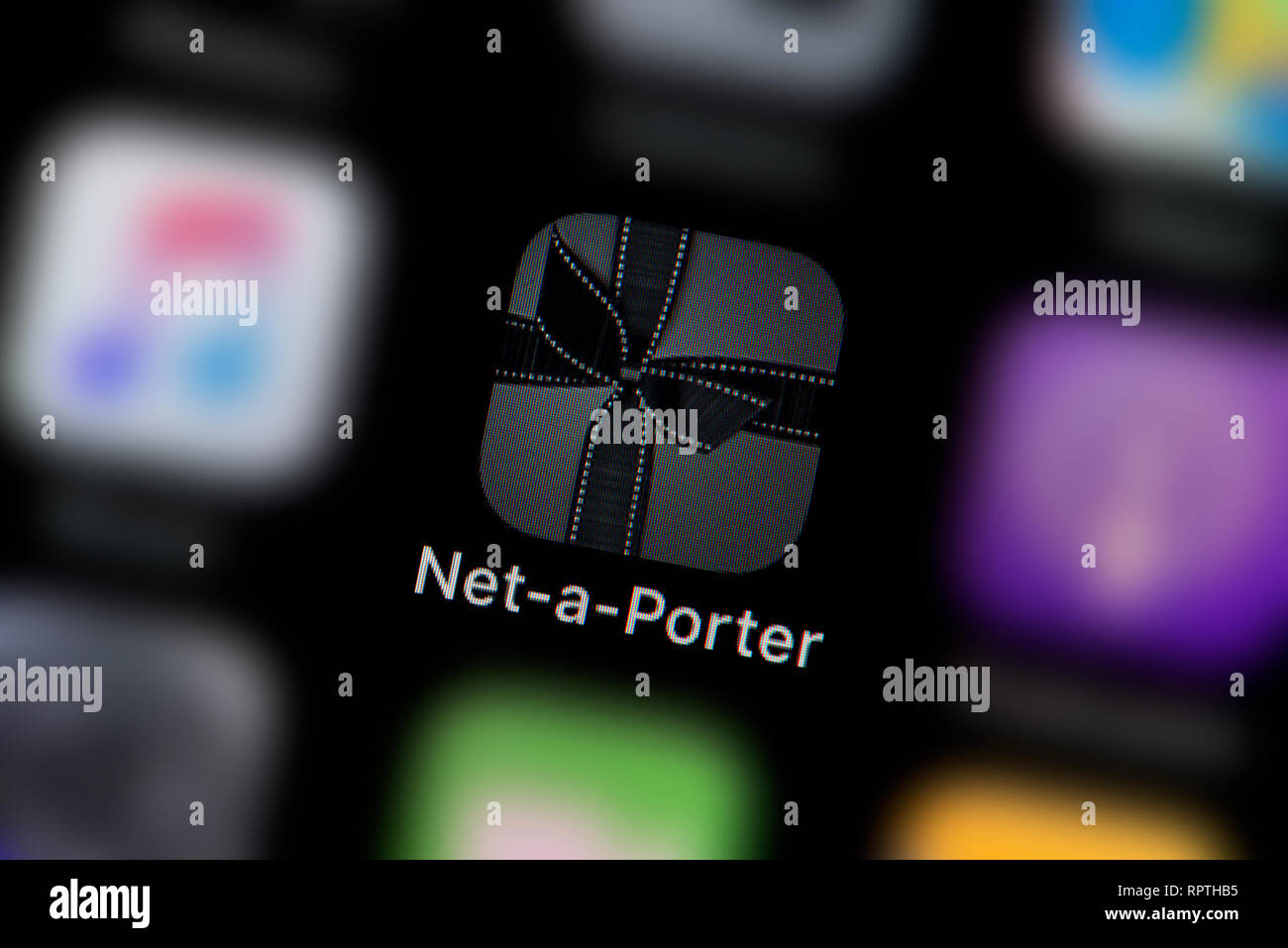 A close-up shot of the Net-a-porter app icon, as seen on the screen of a smart phone (Editorial use only) - Stock Image