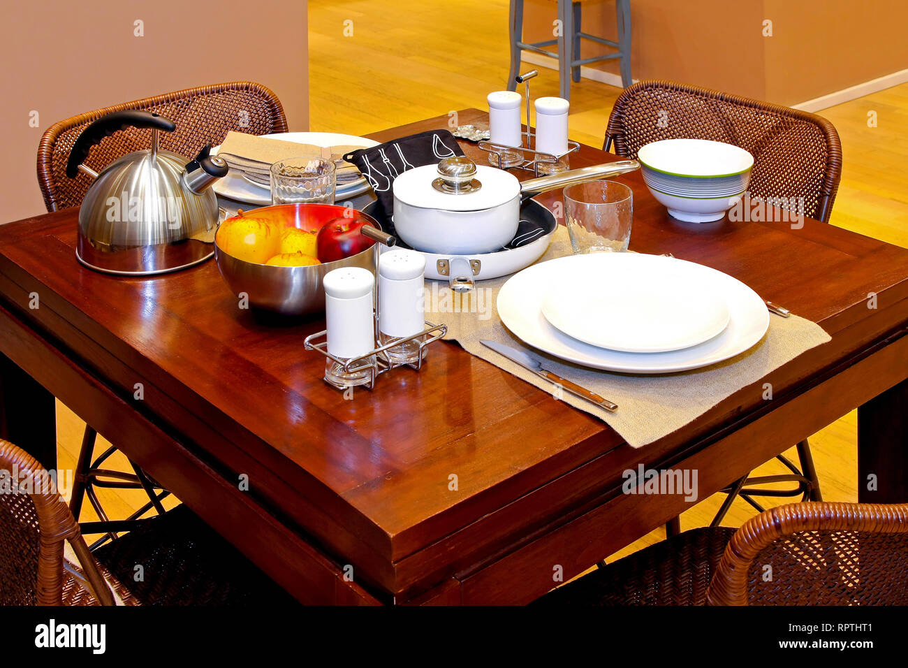 Kitchen table setup for breakfast with teapot Stock Photo   Alamy