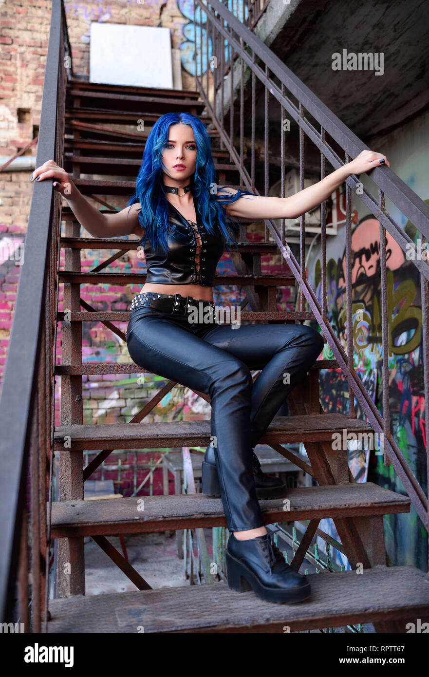 9e37a3521 Beautiful rock girl with blue hair (informal model), dressed in the black  leather