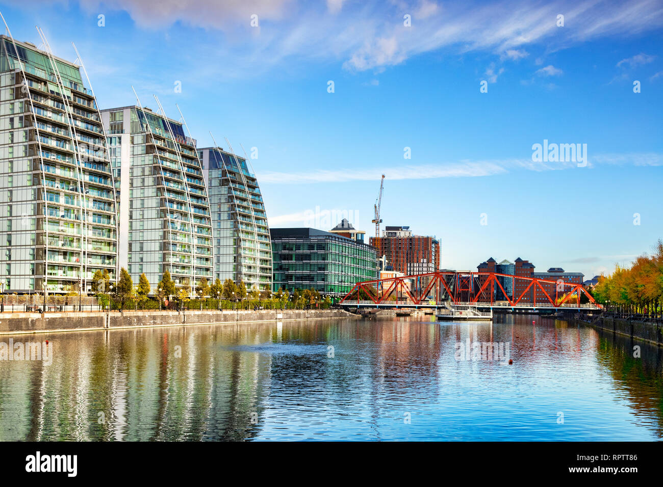 2 November 2018: Salford Quays, Manchester, UK - The Manchester Ship Canal, with the Huron Basin, the Detroit Foot Bridge and the NV apartment buildin - Stock Image