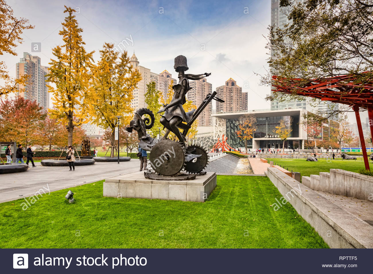 30 November 2018: Shanghai, China - Sculpture 'Flying Colors' by Georges Saulterre in the Jing'an Sculpture Park, with the Shanghai Natural History Mu - Stock Image
