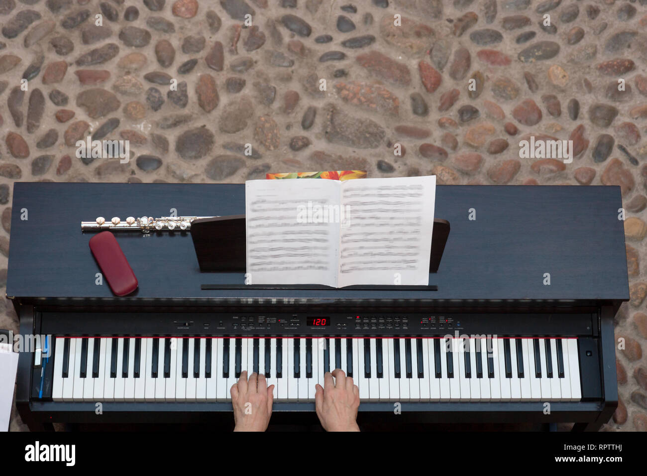 Woman playing an electric piano. view from above - Stock Image