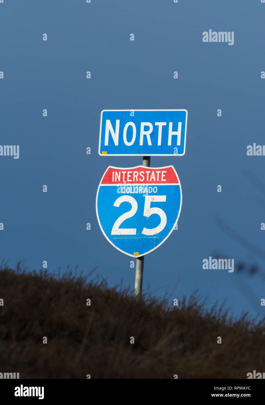 United States interstate highway system road sign in evening light photographed near Castle Rock Colorado US. Photo taken in February. - Stock Image