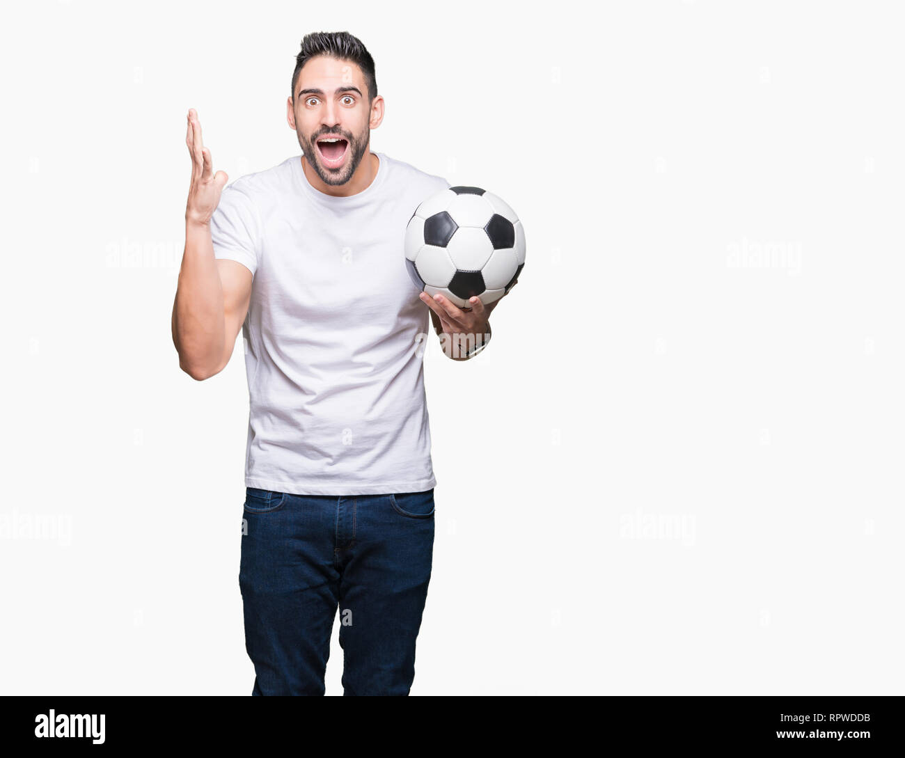 2e0777f4f Young man holding soccer football ball over isolated background very happy  and excited, winner expression