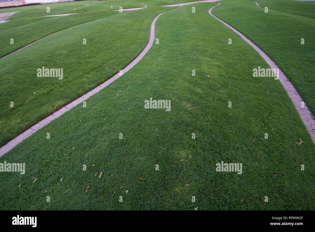 Dubai-Zabeel Park wave strips among the grass close up Stock Photo