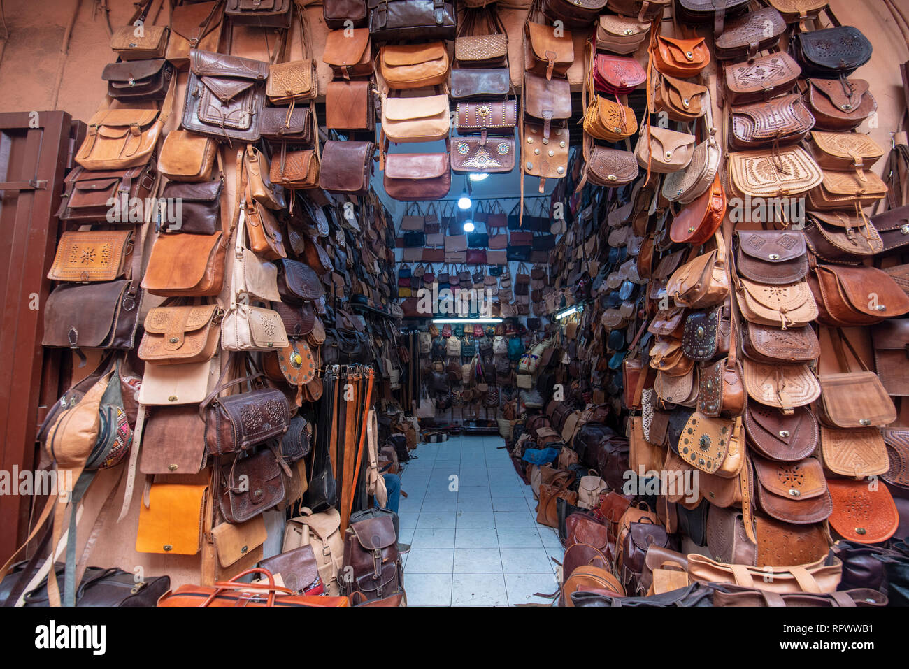 Bags, purses, hats and other products of the Moroccan Handmade leather. Camel, cow and other animal leather. Traditional market - souq. Marrakech - Stock Image