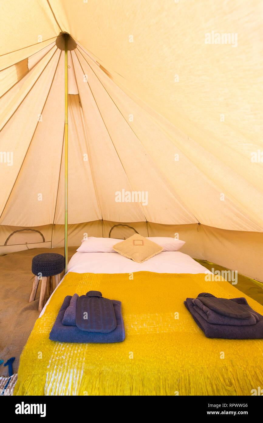 Luxury glamping bell tent interior, Kent, UK - Stock Image