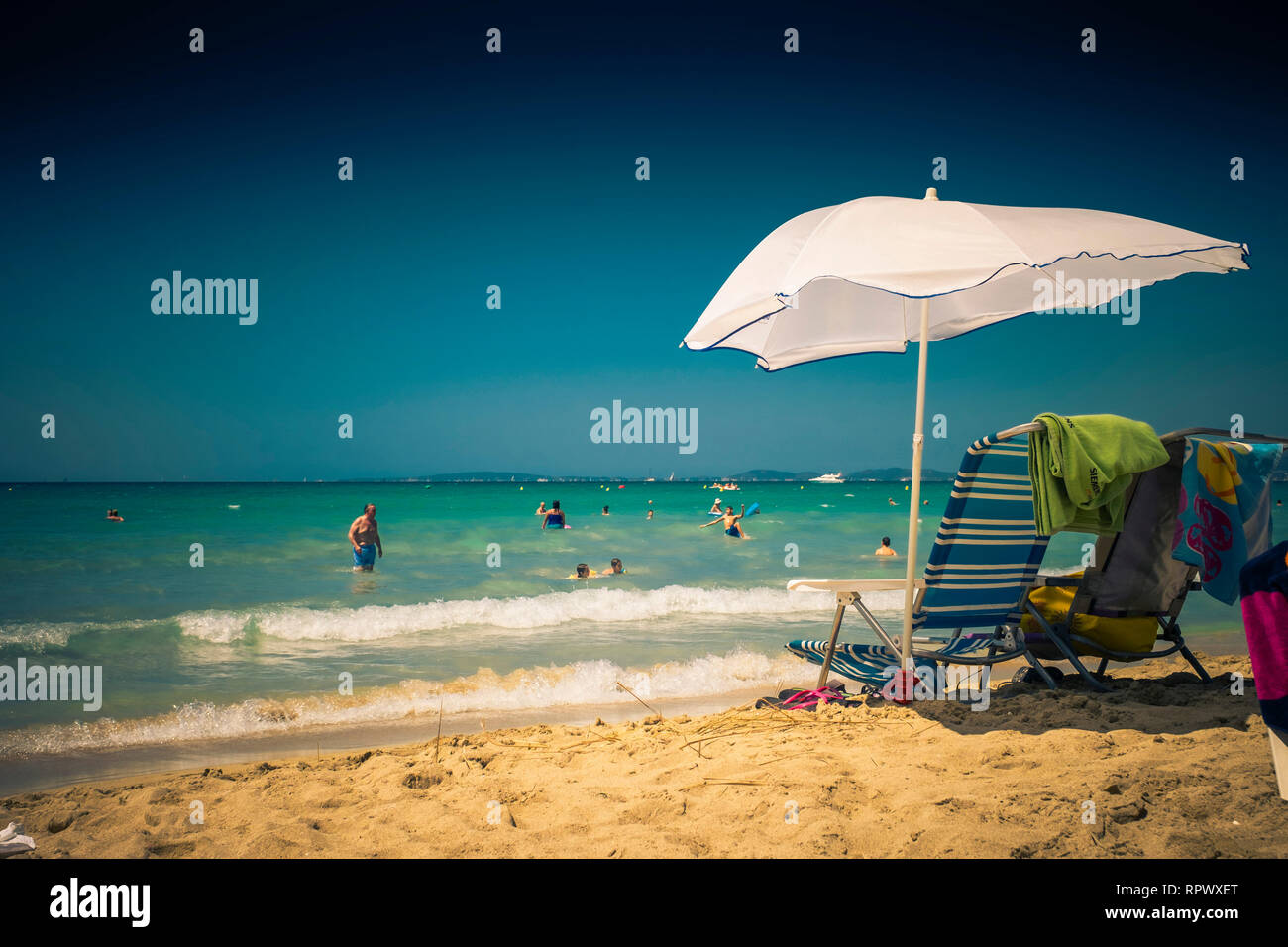 Lazy days on the beach. - Stock Image
