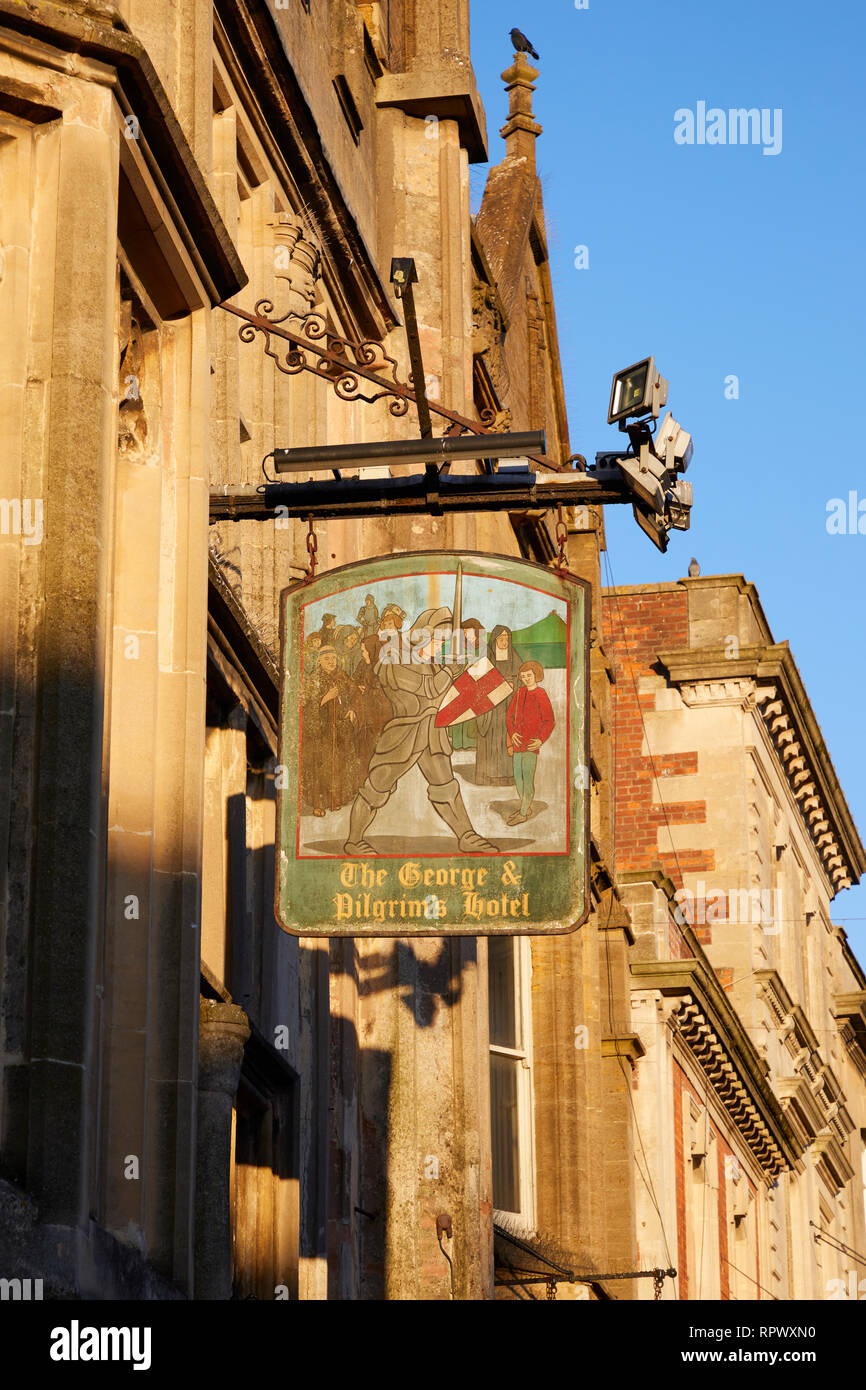 A sign for the George Hotel and Pilgrims Inn, Glastonbury, Somerset - Stock Image