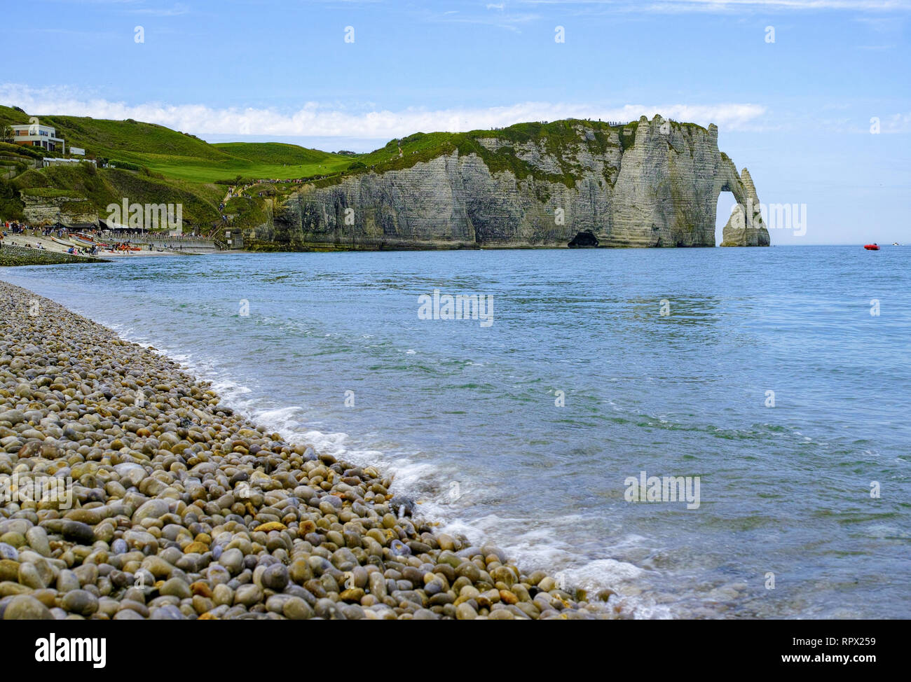 Landscape with scenic alabaster chalk cliffs of Etretat and coast of Atlantic ocean, travel and vacation destination in Normandy, France - Stock Image