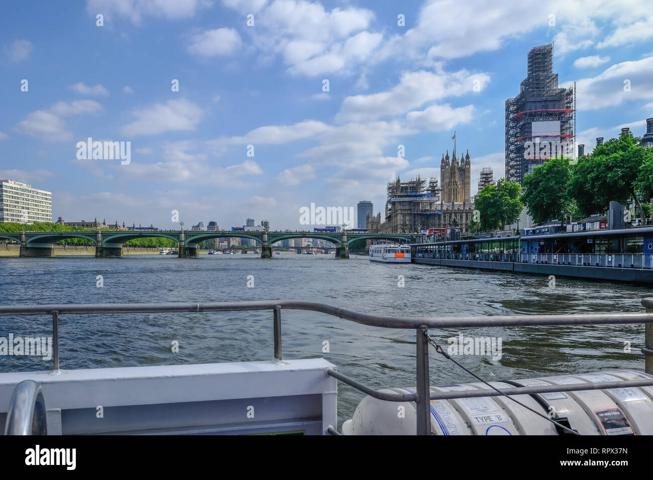 Westminster, London, uk - June 8, 2018: Viewof Westminter bridge with Big Ben under renovation and Houses of Parliament.  Taken from a clipper in the  Stock Photo