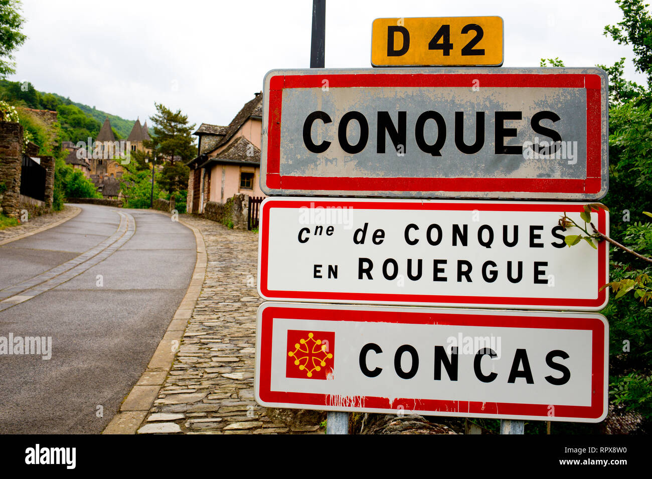 Sign at the entrance to Conques in France - Stock Image