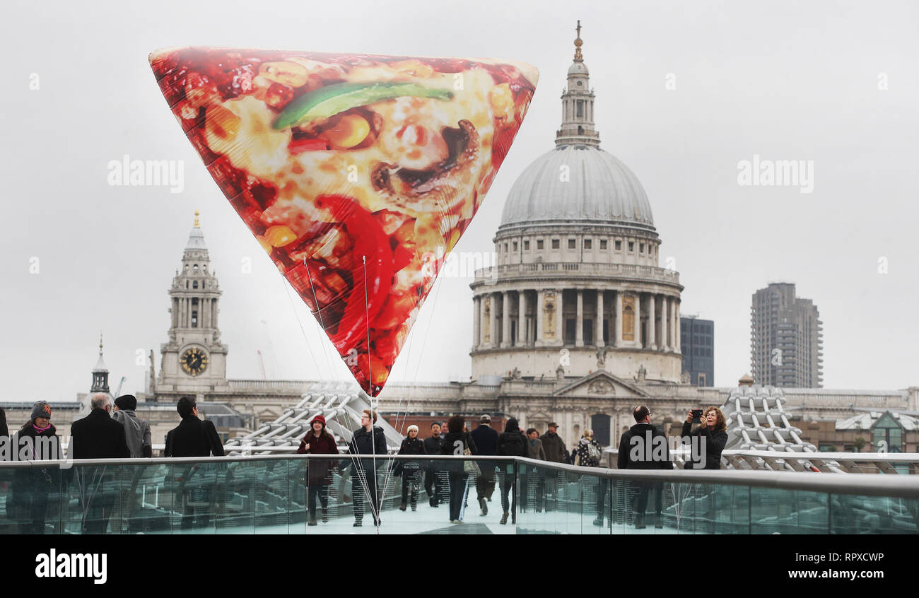 To celebrate the introduction of a new range of 650kcal Delight pizzas to its menu, Domino's is floating giant, inflatable Slices of Delight around London today to help lift the January blues. 1,000 people who spot and share a picture on Twitter using the #SliceOfDelight hashtag will be rewarded with a free Delight pizza. Pizza lovers up across the country can retweet the snap from @Dominos_UK to be included in the 1,000 lucky winners.  Featuring: Atmosphere Where: London, United Kingdom When: 16 Jan 2019 Credit: Joe Pepler/PinPep/WENN.com - Stock Image