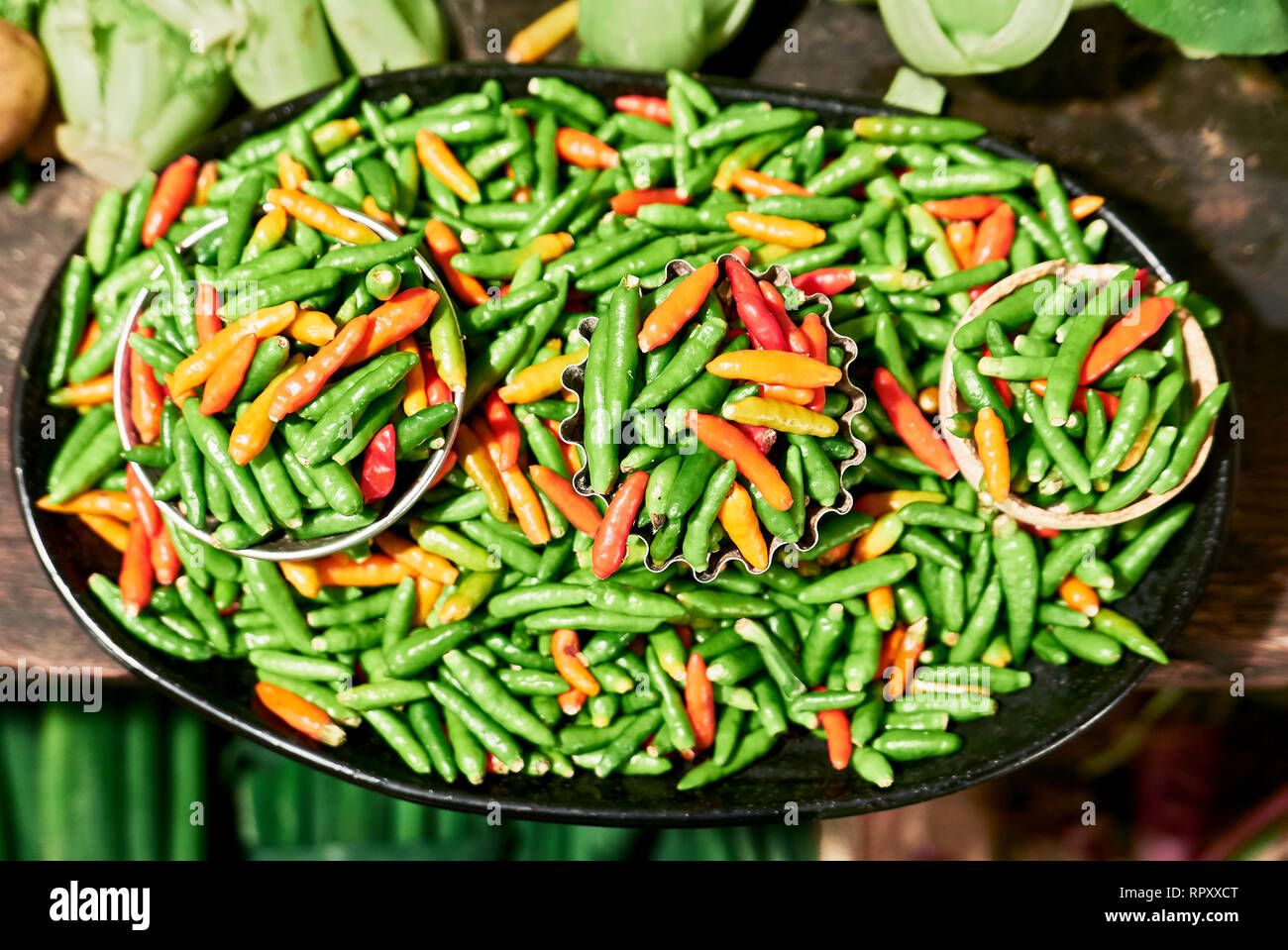 Close Up Of Plenty Small Green And Red Chili Placed On A Plate With