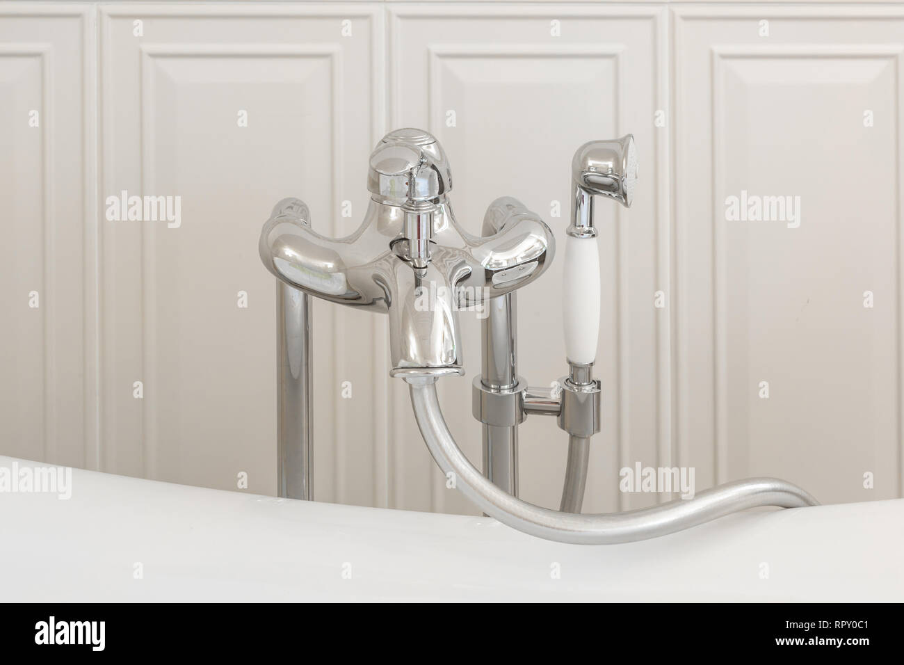 detail of a corner shower cabin with wall mount shower attachment - Stock Image