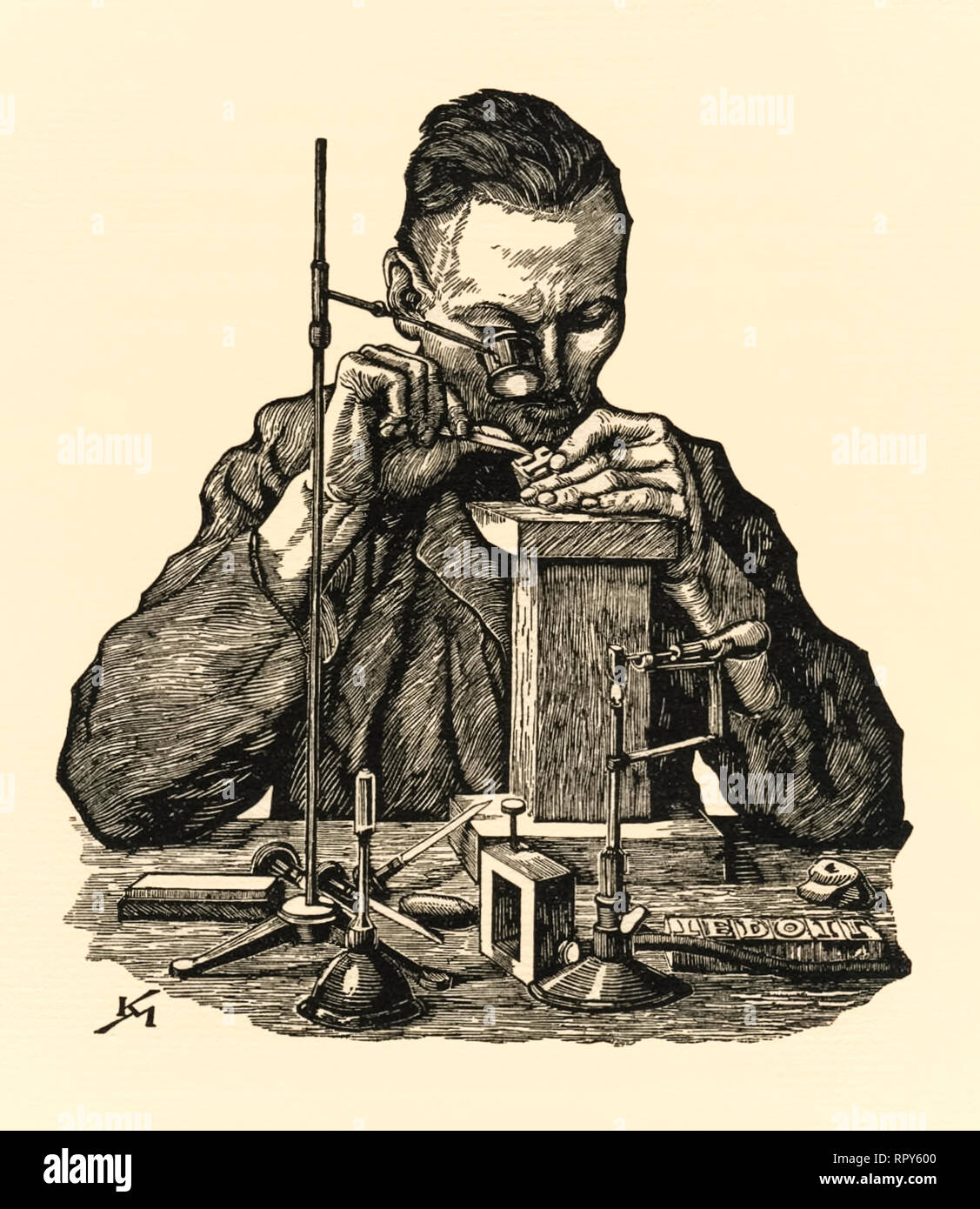 Preparing metal type for use in letterpress printing. Here a cast metal glyph is inspected a metal sort using a loupe and deburring the face with a tool. Woodcut by Karl Mahr (1890-1945). - Stock Image