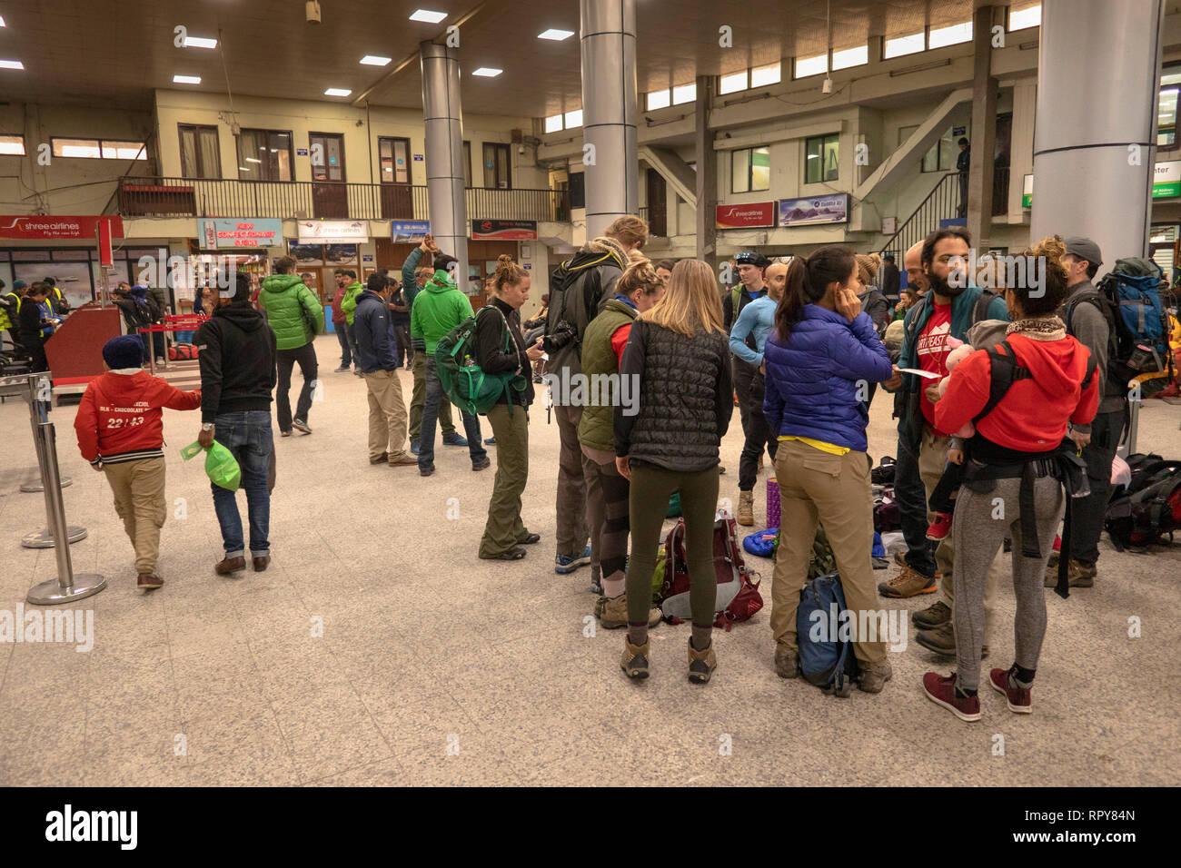 Nepal, Kathmandu, Tribhuvan International airport, domestic departure area, passengers waiting for delayed flights to Lukla - Stock Image