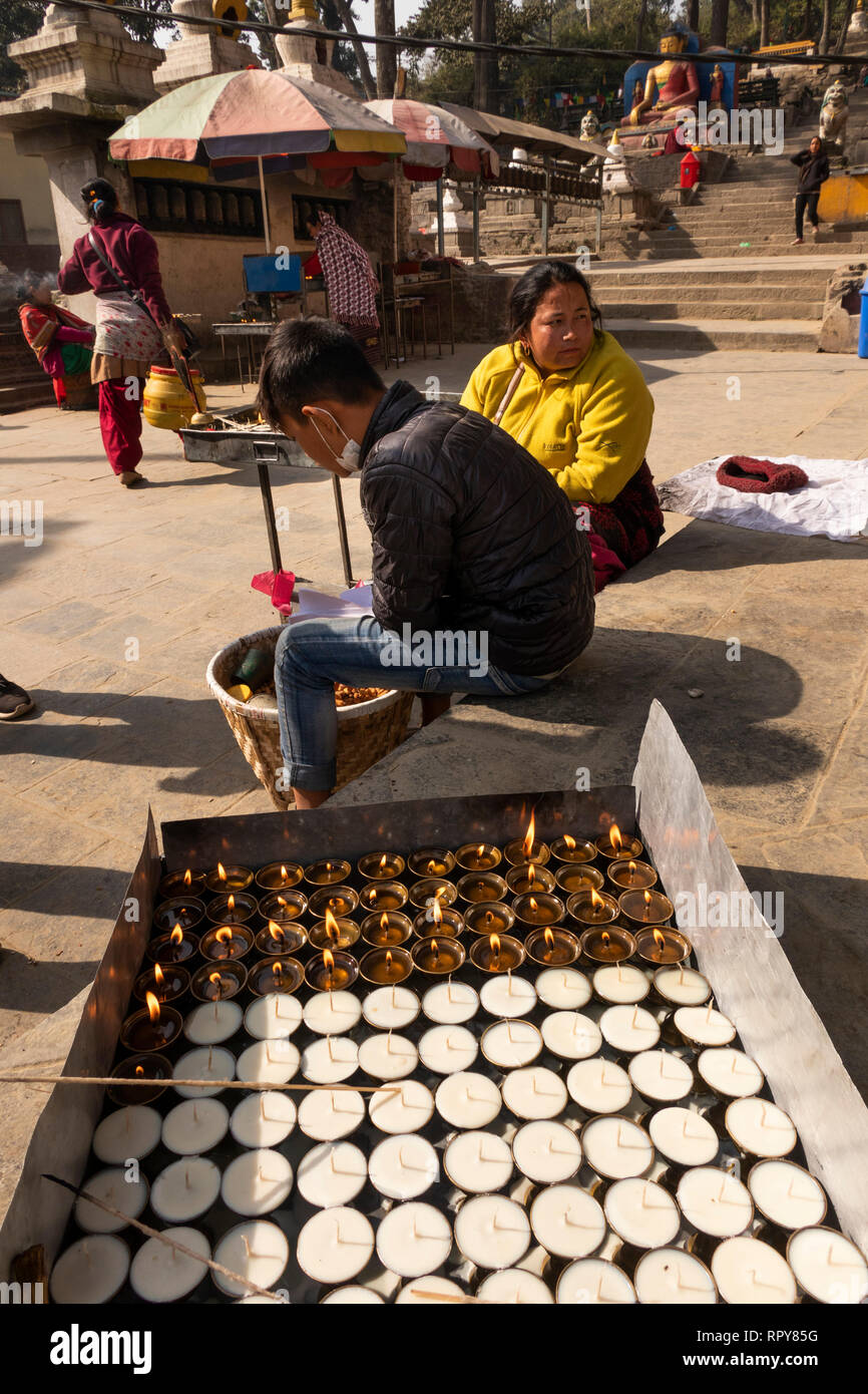 Nepal, Kathmandu, Swayambhunath Temple, night lights in place of traditional butter lamps at base of steps - Stock Image