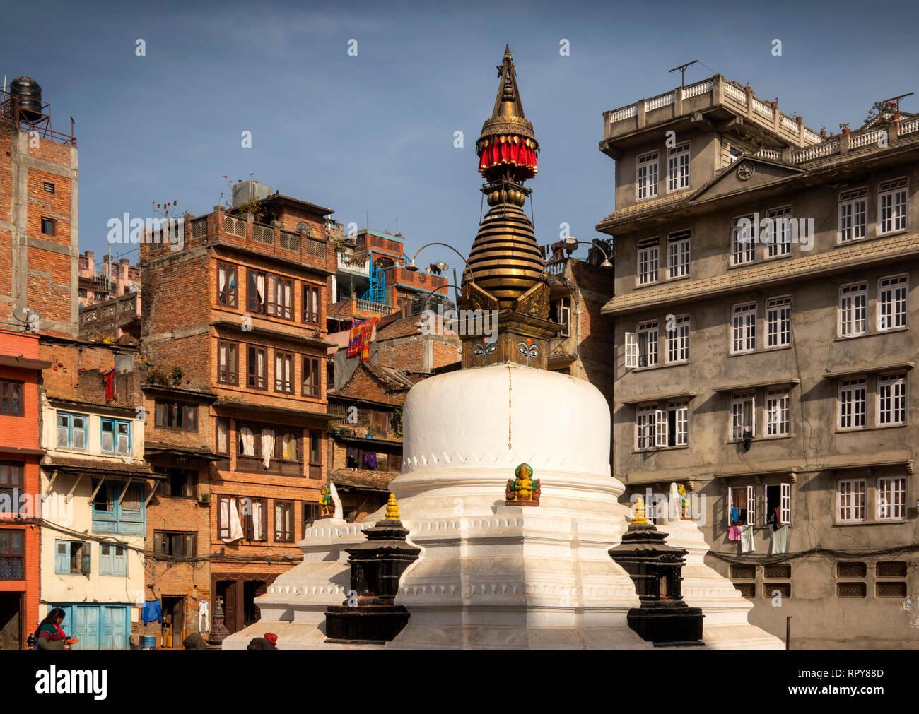 Nepal, Kathmandu, city centre,Yatkha Bahal, Kathesimbhu Stupa, surrounded by tall modern buildings - Stock Image