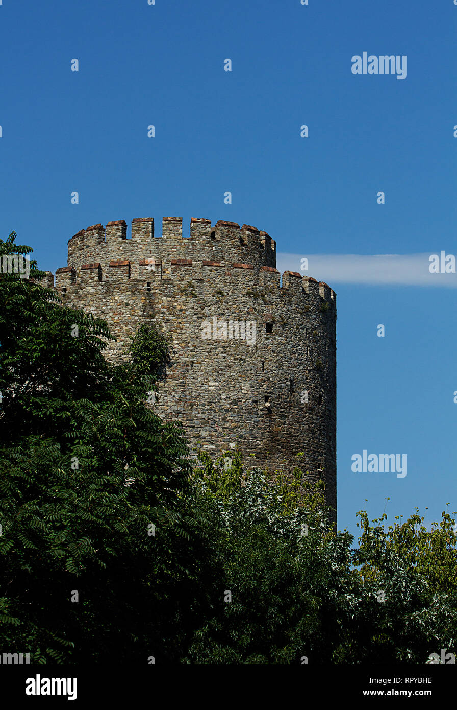 A tower of the Rumelihisar Fortress in Istanbul, Turkey used during the conquest of Constantinopolis. Stock Photo
