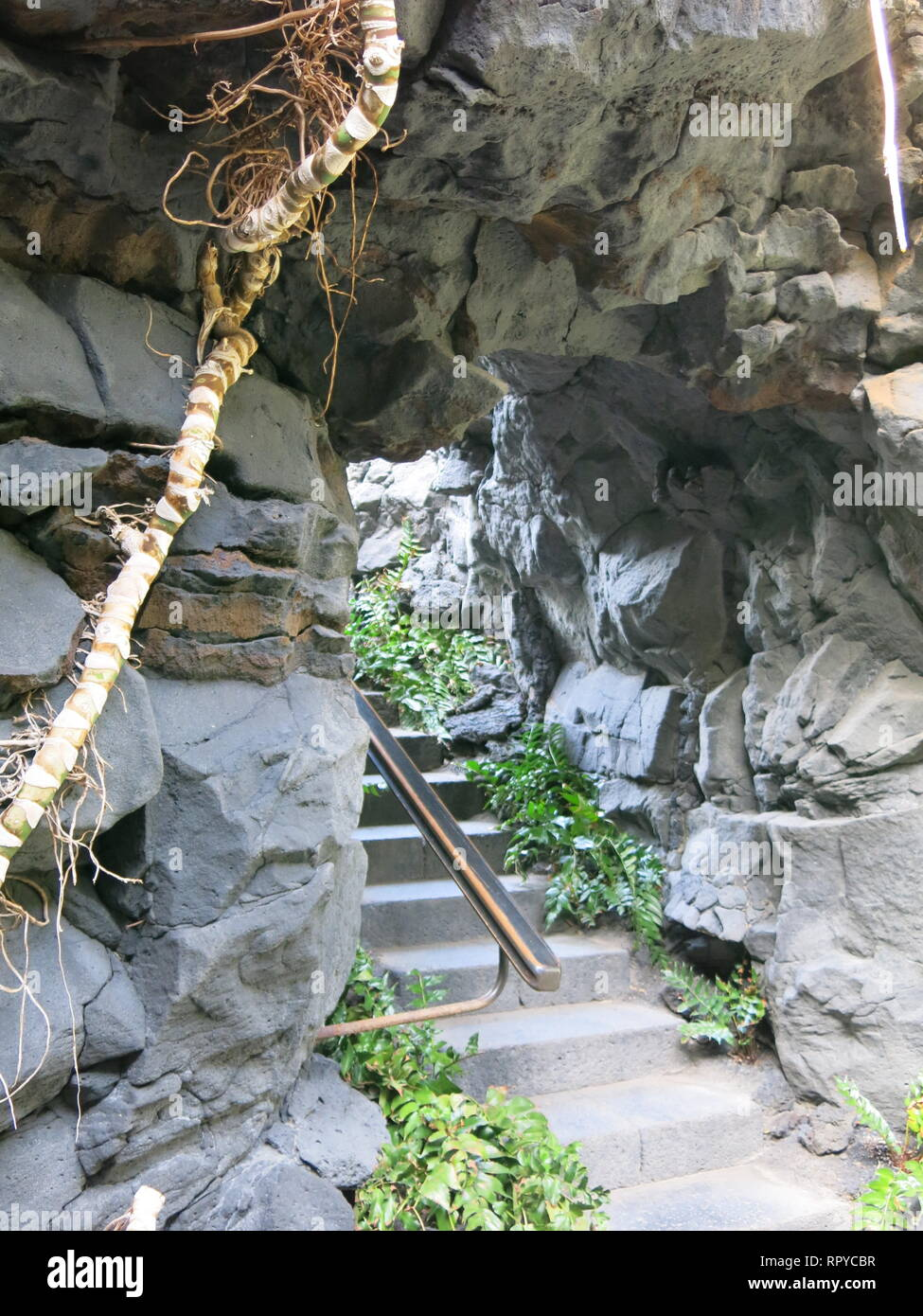 A staircase hewn from the basalt rock is a feature of the former home of Cesar Manrique, built in the lava bubbles after volcanic eruption. - Stock Image