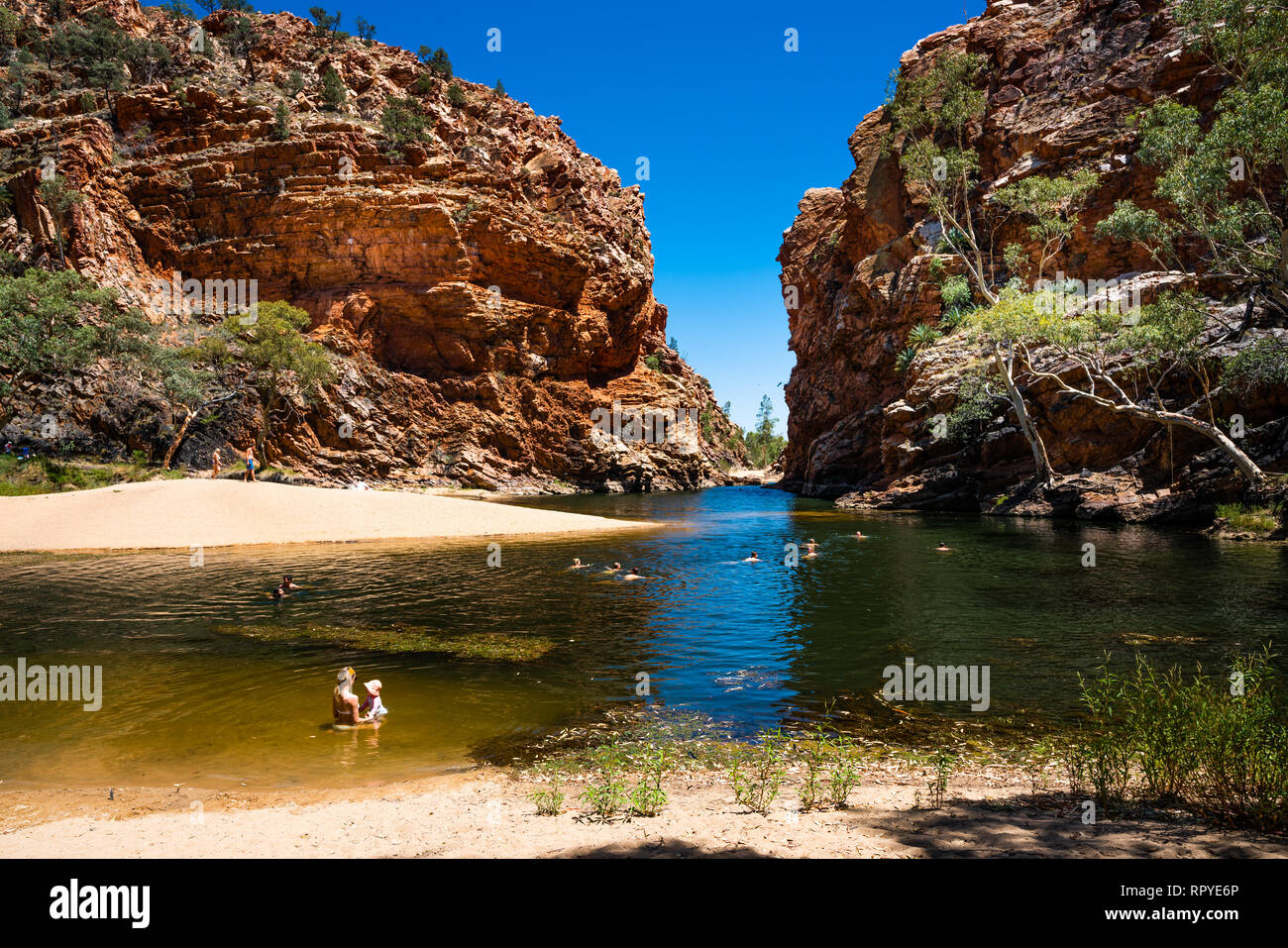 27th December 2018, NT Australia : People swimming in Ellery creek big hole in the West MacDonnell Ranges NT outback Australia - Stock Image