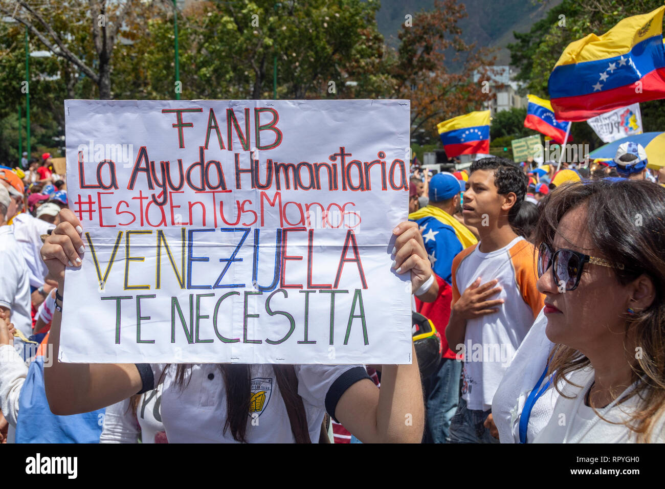 The citizens of Caracas gathered at the La Carlota air base to ask the Armed Forces to allow humanitarian aid into Venezuela and lay down their arms f Stock Photo