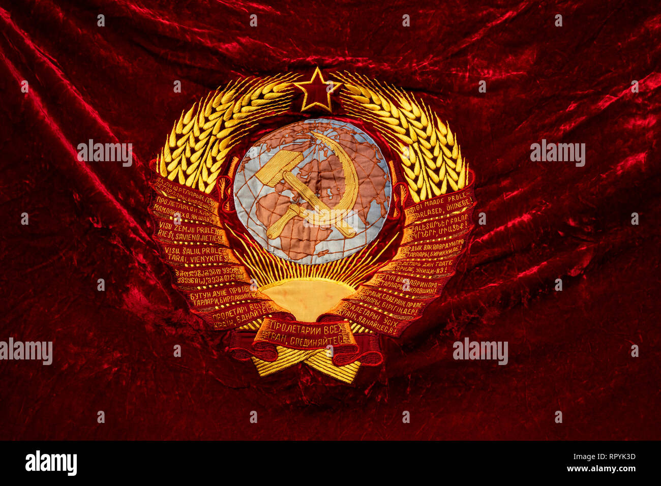 Moscow, Russia. 23 February, 2019: A banner with the emblem of the USSR in a march of the Russian Communist Party in central Moscow to mark the 101st anniversary of establishment of the Red Army and the Navy on Defender of the Fatherland Day Credit: Nikolay Vinokurov/Alamy Live News - Stock Image