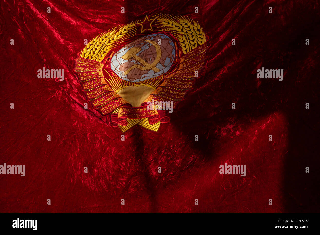 Moscow, Russia. 23 February, 2019: Banner with the emblem of the USSR in a march of the Russian Communist Party in central Moscow to mark the 101st anniversary of establishment of the Red Army and the Navy on Defender of the Fatherland Day Credit: Nikolay Vinokurov/Alamy Live News - Stock Image
