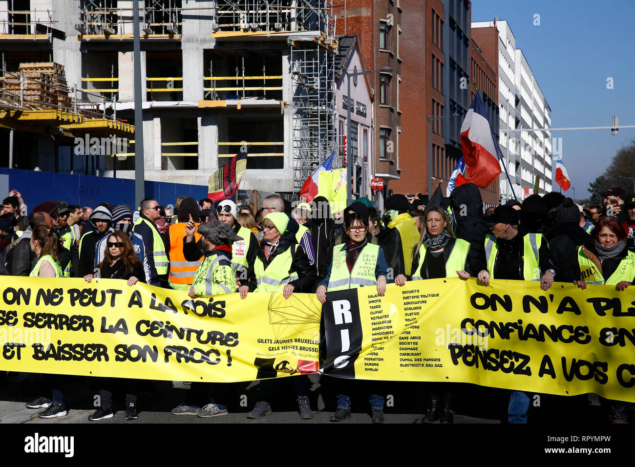 Brussels, Belgium. 23rd February 2019. People take part in a protest march of the yellow vests against government's policy . Alexandros Michailidis/Alamy Live News Stock Photo