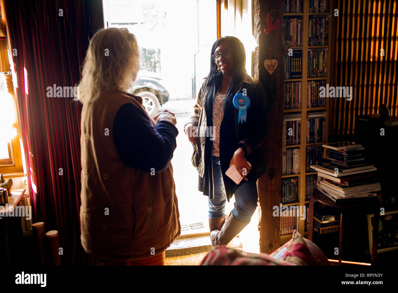 Thaxted, Essex, England. 23rd February 2019. Kemi Badenoch Conservative MP for Saffron Walden Essex UK campaigning for two local council candidates in the Uttlesford District Council ( UDC ) election to be held on 2 May 2019. She is seen here talking to local resident Nicola Bertoya about issues of concern such as speeding motorists in the area.  Olukemi Olufunto Badenoch (née Adegoke; born January 1980)is a British Conservative politician and Member of Parliament for Saffron Walden. Adegoke was born in Wimbledon, London to parents of Nigerian origin. Credit: BRIAN HARRIS/Alamy Live News - Stock Image