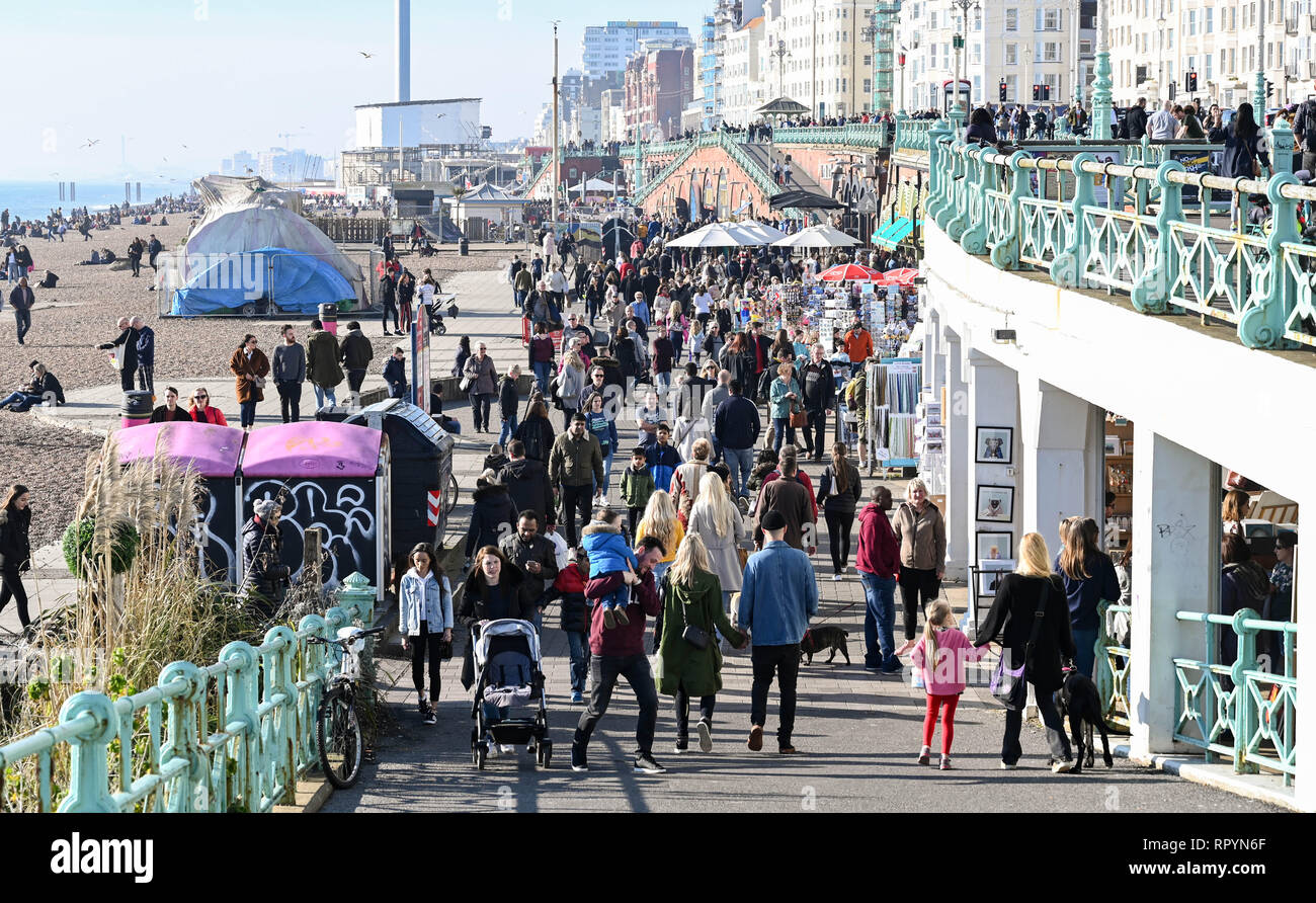 Brighton, Sussex,  UK.  23rd February 2019.  Crowds flock to Brighton seafront and beach as they enjoy the beautiful sunny and unusually warm weather for the time of year with it forecast set to continue over the next few days throughout Britain Credit: Simon Dack/Alamy Live News - Stock Image