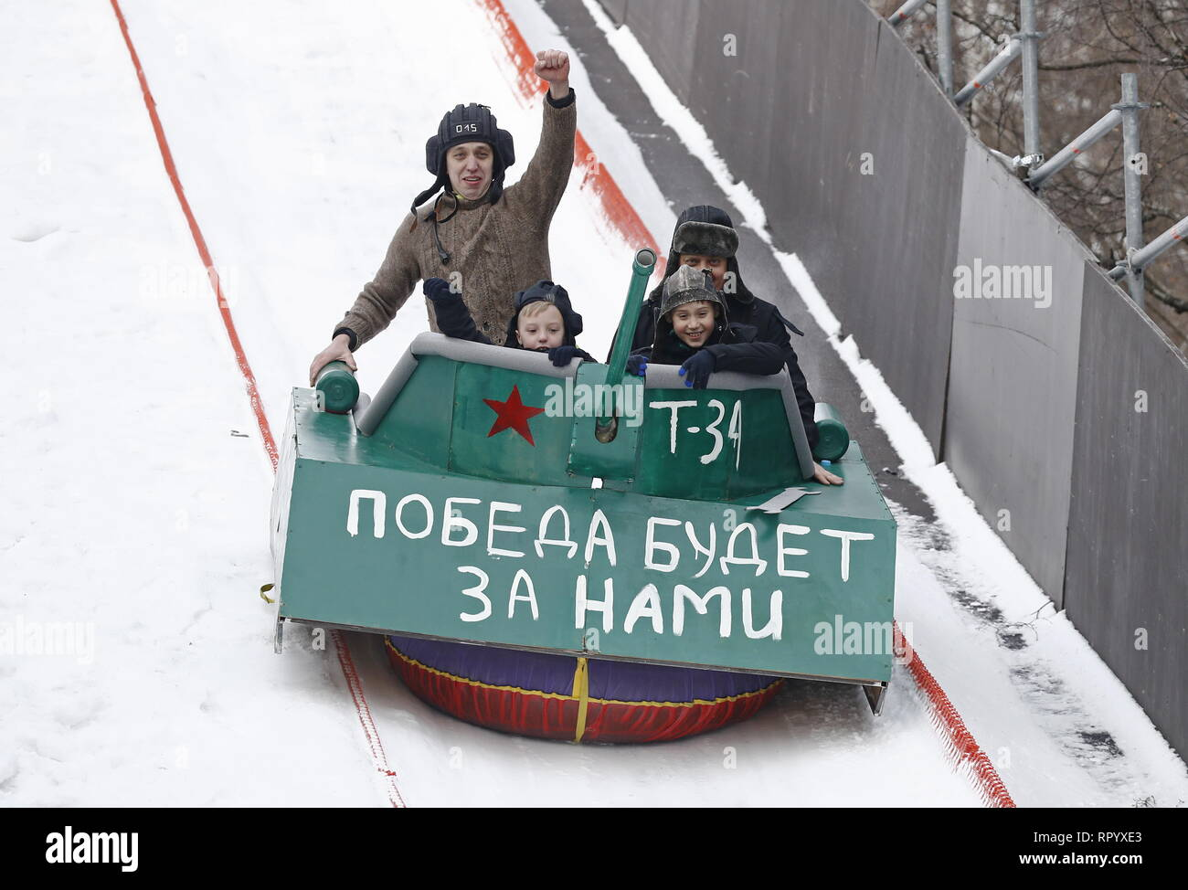 Moscow, Russia. 23rd Feb, 2019. MOSCOW, RUSSIA - FEBRUARY 23, 2019: Participants ride the sledge they have designed for the Battle Sani creative sledge festival in Moscow. Artyom Geodakyan/TASS Credit: ITAR-TASS News Agency/Alamy Live News Stock Photo