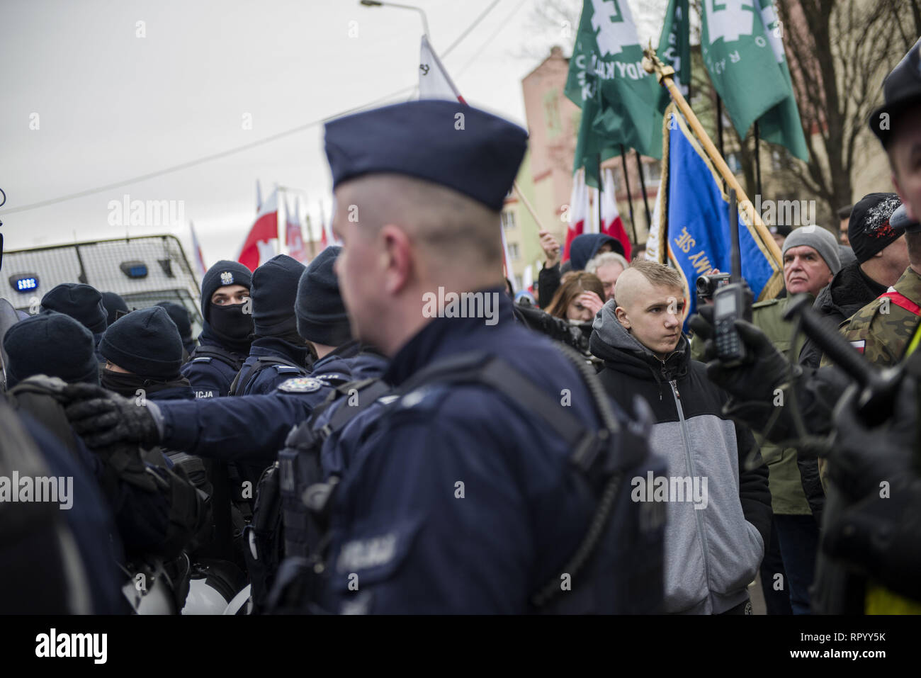 Hajnowka, Poldlaskie, Poland. 23rd Feb, 2019. Police forces seen providing protection during the march.Polish nationalists organized a commemorative march of the 'Cursed Soldiers'' in the city of Hajnowka next to the Belarusian border. The Cursed Soldiers also known as the Doomed Soldiers were anti-communist resistant fighters after WWII, however they were also famous of committing crimes against civilians, mostly ethnic Belarusians. Credit: Attila Husejnow/SOPA Images/ZUMA Wire/Alamy Live News - Stock Image