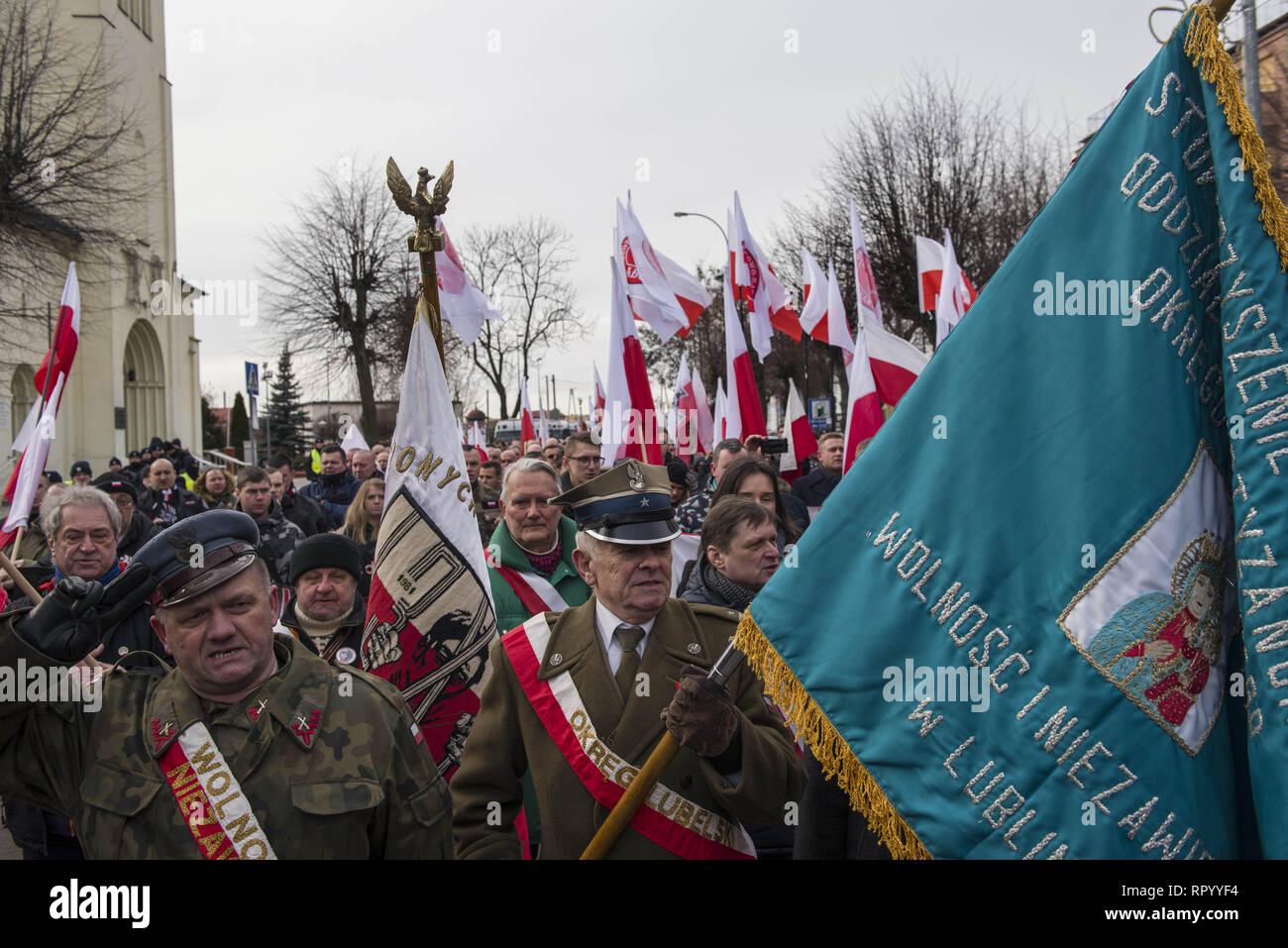 Hajnowka, Poldlaskie, Poland. 23rd Feb, 2019. Nationalists seen singing the Polish anthem during the march.Polish nationalists organized a commemorative march of the 'Cursed Soldiers'' in the city of Hajnowka next to the Belarusian border. The Cursed Soldiers also known as the Doomed Soldiers were anti-communist resistant fighters after WWII, however they were also famous of committing crimes against civilians, mostly ethnic Belarusians. Credit: Attila Husejnow/SOPA Images/ZUMA Wire/Alamy Live News - Stock Image