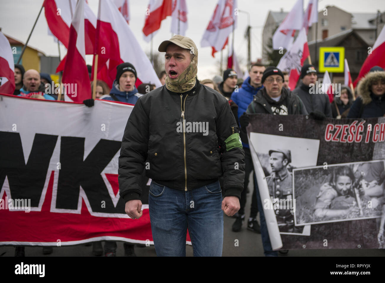 Hajnowka, Poldlaskie, Poland. 23rd Feb, 2019. A nationalist is seen shouting slogans during the march.Polish nationalists organized a commemorative march of the 'Cursed Soldiers'' in the city of Hajnowka next to the Belarusian border. The Cursed Soldiers also known as the Doomed Soldiers were anti-communist resistant fighters after WWII, however they were also famous of committing crimes against civilians, mostly ethnic Belarusians. Credit: Attila Husejnow/SOPA Images/ZUMA Wire/Alamy Live News - Stock Image
