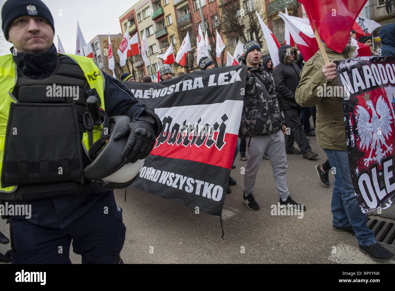 Hajnowka, Poldlaskie, Poland. 23rd Feb, 2019. Polish nationalists seen marching with patriotic banners to commemorate the Cursed Soldiers.Polish nationalists organized a commemorative march of the 'Cursed Soldiers'' in the city of Hajnowka next to the Belarusian border. The Cursed Soldiers also known as the Doomed Soldiers were anti-communist resistant fighters after WWII, however they were also famous of committing crimes against civilians, mostly ethnic Belarusians. Credit: Attila Husejnow/SOPA Images/ZUMA Wire/Alamy Live News - Stock Image