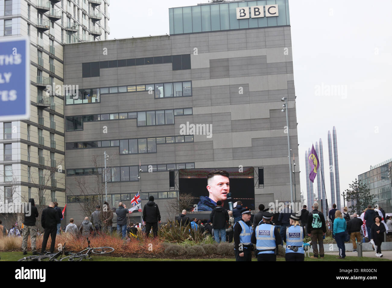 Manchester, UK. 23rd Feb, 2019. A big screen set up by former EDL leader Tommy Robinson outside the BBC, Media City, Salford, UK. 23rd Feb, 2019. (C)Barbara Cook/Alamy Live News Credit: Barbara Cook/Alamy Live News Credit: Barbara Cook/Alamy Live News - Stock Image