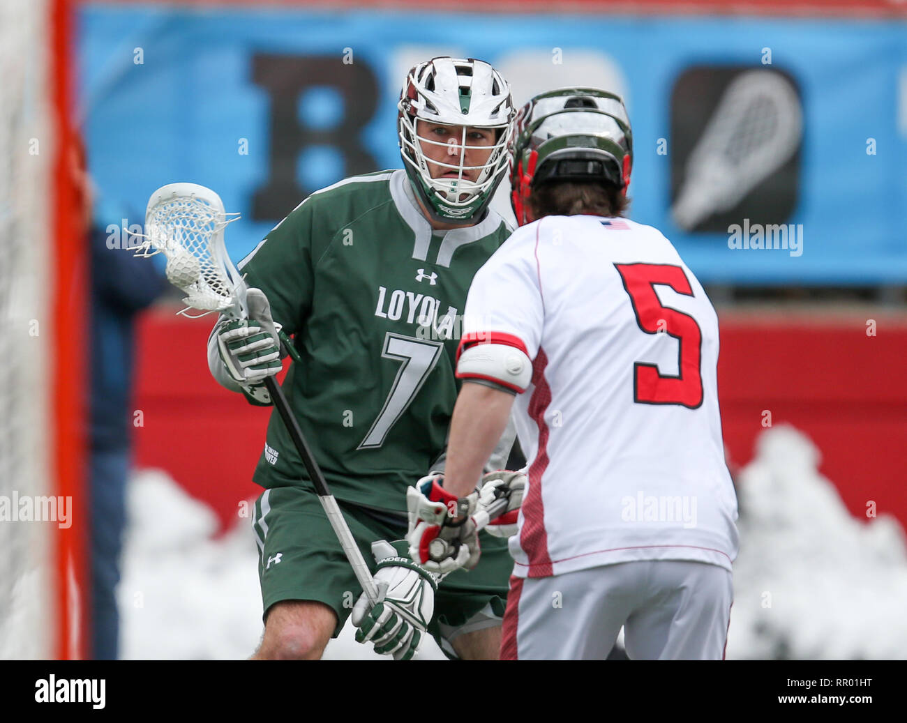 Piscataway, NJ, USA. 23rd Feb, 2019. Loyola Greyhounds attacker Pat Spencer (7) tries to put a move on Rutgers defenseman Kyle Pless (5) during an NCAA men's lacrosse game between Loyola University Maryland and the Rutgers Scarlet Knights at HighPoint.com stadium in Piscataway, NJ. Mike Langish/Cal Sport Media. Credit: csm/Alamy Live News - Stock Image
