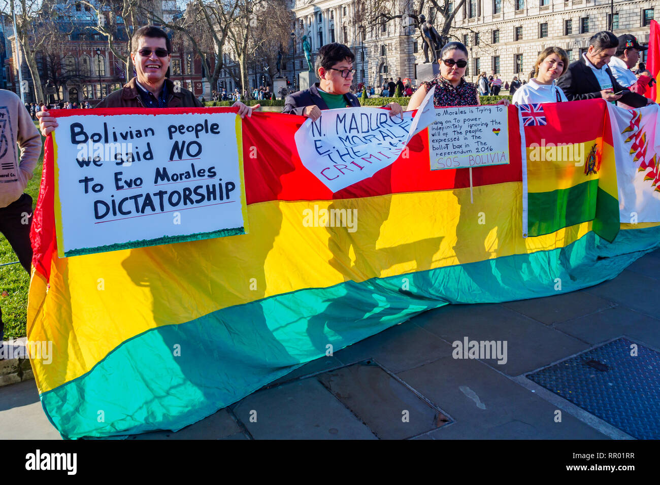 London, UK. 23rd February 2019.  Bolivians protest in Parliament Square against President Evo Morales, saying he is a dictator and accuse him of corruption and interfering with the court system to remain in power. Bolivia's Electoral Tribunal ruled in December that he could stand for a fourth term in office in the November 2019 elections, despite a referendum on 21st Feb 2016. which narrowly rejected changing the 2009 constitution to allow the President to serve more than two consecutive terms. Peter Marshall/Alamy Live News Stock Photo