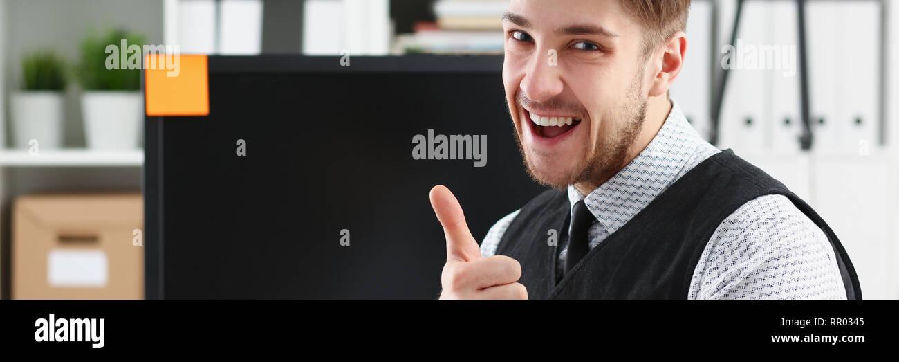 Businessman showing thumbs up - closeup shot - Stock Image